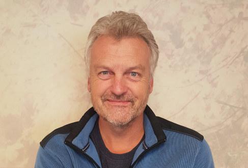 Portrettbilde av Tore Hølmo.